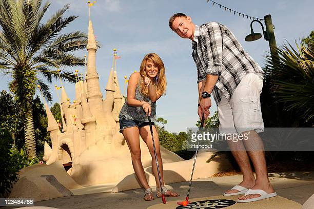 Vienna Girardi and Kasey Kahl two stars from the ABC reality series 'Bachelor Pad' line up a putt on September 3 2011 at Disney's Winter Summerland...