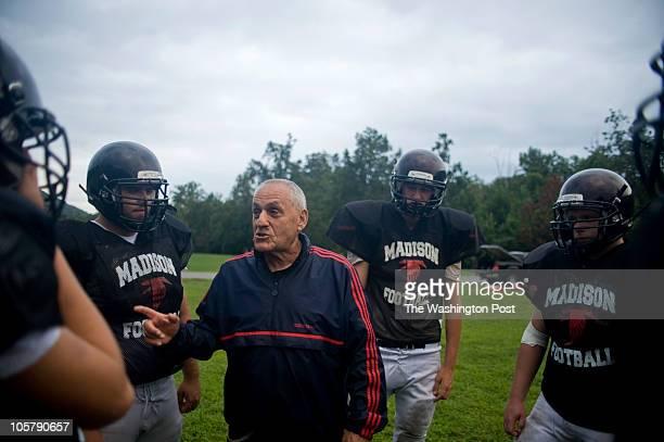 Vienna Madison High School football coach Art Kojoyian teaches strategies during a practice on Aug. 24, 2010. Art Kojoyian has been coaching football...