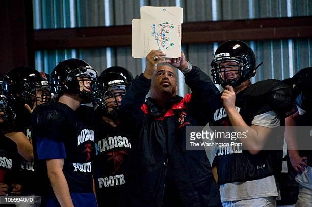 Vienna Madison High School football coach Tony Thomas teaches strategies during a practice on Aug. 24, 2010. Art Kojoyian has been coaching football...