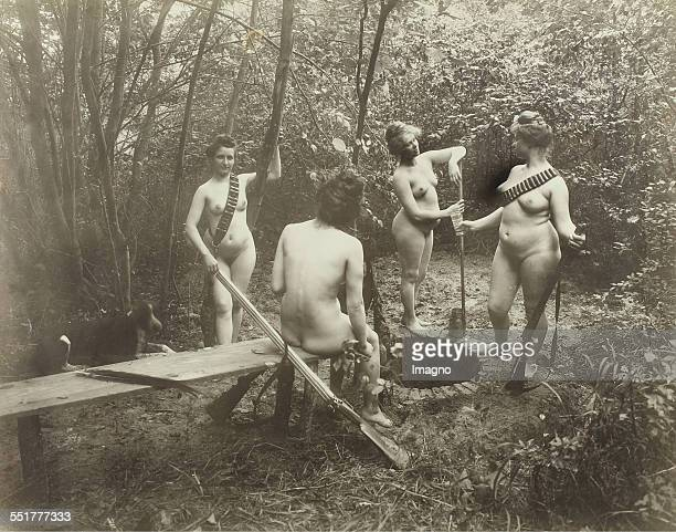 Vienna 'Nackedeien' of the Gründerzeit Four naked girl with cartridge belts and rifles in the preparation of a picnic in the forest 1906 Photograph