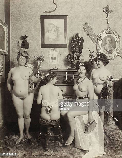 Vienna 'Nackedeien' of the Gründerzeit Four naked girls with musical instruments and body jewelry at a piano 1906 Photograph