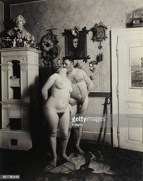 Vienna 'Nackedeien' of the Gründerzeit Nude girl and a naked man are kissing in the living room1906 Photograph