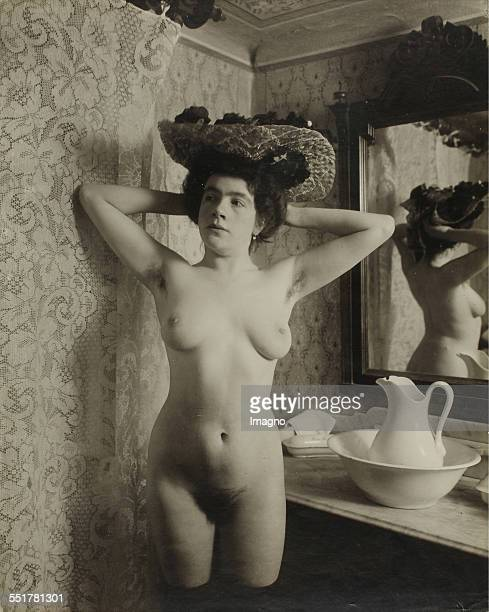 Vienna 'Nackedeien' of the Gründerzeit Nude girl with flower hat arms folded behind her head the washbasin 1906 Photograph