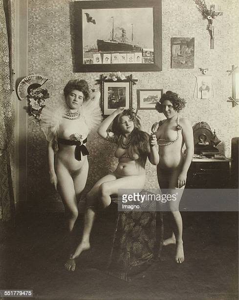Vienna 'Nackedeien' of the Grnderzeit Three naked girls adorned with strange bands and chains around their breasts in the bedroom 1906 Photograph