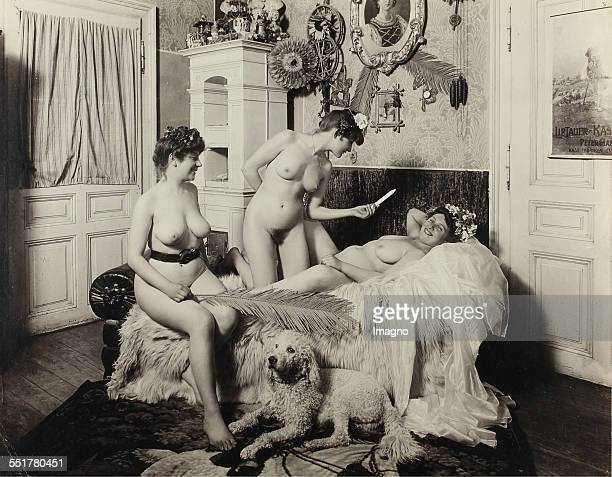 Vienna 'Nackedeien' of the Gründerzeit Three naked girls and a poodle in the living room A girl lying on a chaiselongue 1906 Photograph