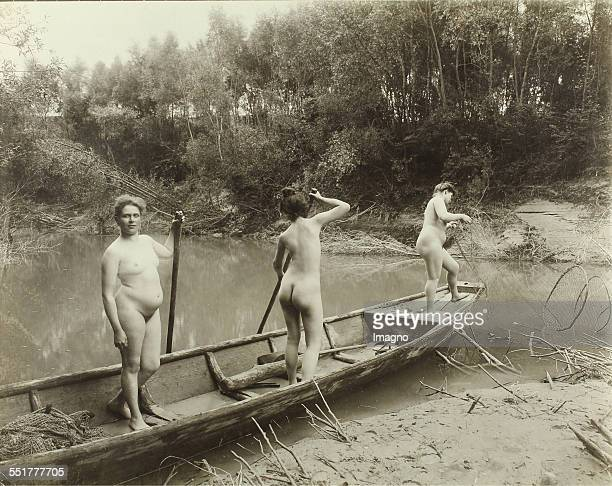 Vienna 'Nackedeien' of the Gründerzeit Three naked girls in a boat on a side of a river 1906 Photograph