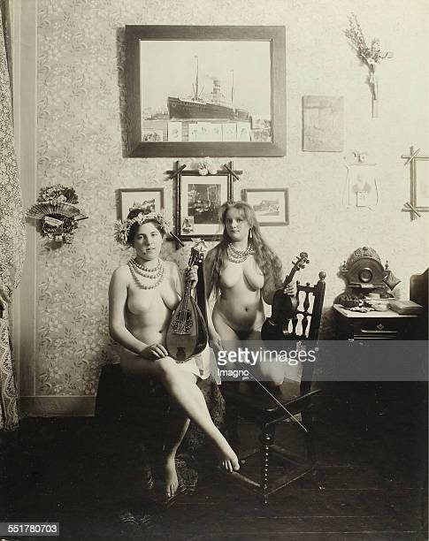 Vienna 'Nackedeien' of the Gründerzeit Two naked girl with mandolin and violin 1906 Photograph