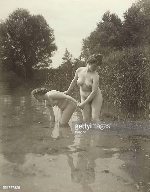 Vienna 'Nackedeien' of the Gründerzeit Two naked girls bathing in a tributary of a river 1906 Photograph