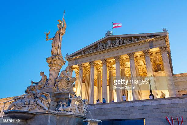 vienna, parliament building at dusk - austria stock pictures, royalty-free photos & images