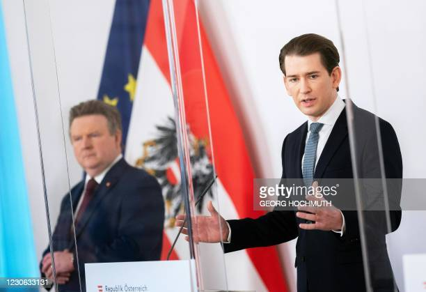 Vienna's Mayor Michael Ludwig listens as Austrian Chancellor Sebastian Kurz addresses a government press conference on the current situation...