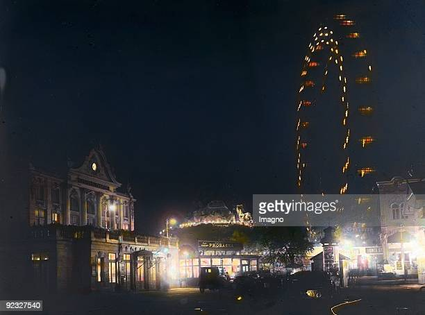 Viennese Riesenrad and Lustspieltheater by night Prater Vienna 2nd district Photograph by Emil Mayer Handcolored lantern slide Around 1910