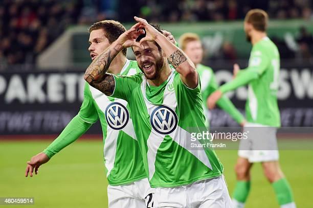 Vierinha and Sebastian Jung of Wolfsburg celebrate an own goal by Rafa of Paderborn during the Bundesliga match between VfL Wolfsburg and SC...