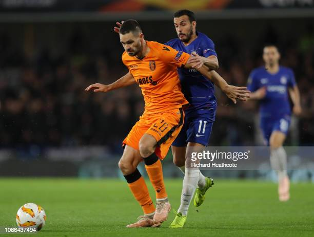 Vierinha of PAOK FC is challenged by Pedro of Chelsea during the UEFA Europa League Group L match between Chelsea and PAOK at Stamford Bridge on...
