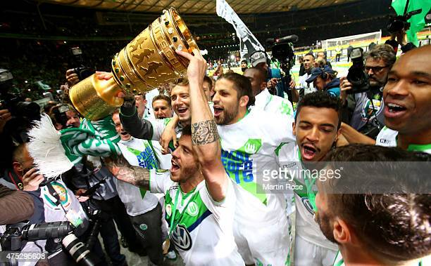 Vierinha of VfL Wolfsburg celebrates with the trophy after winning the DFB Cup Final match between Borussia Dortmund and VfL Wolfsburg at...
