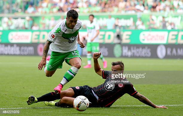 Vierinha of VfL Wolfsburg is challenged by David Abraham of Eintracht Frankfurt during the Bundesliga match between VfL Wolfsburg and Eintracht...