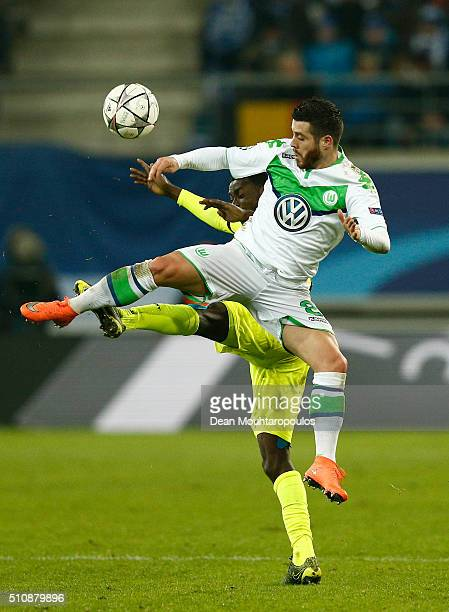 Vierinha of Wolfsburg and Nana Asare of KAA Gent copete for the ball during the UEFA Champions League round of 16 first leg match between KAA Gent...
