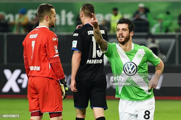 Vierinha of Wolfsburg celebrates as Christian Strohdiek and goalkeeper Lukas Kruse of Paderborn react following an own goal by Rafa of Paderborn...