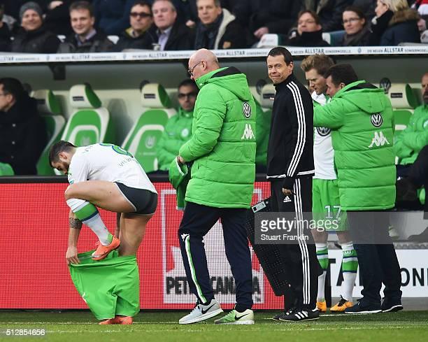 Vierinha of Wolfsburg changes his shorts during the Bundesliga match between VfL Wolfsburg and FC Bayern Muenchen at Volkswagen Arena on February 27...