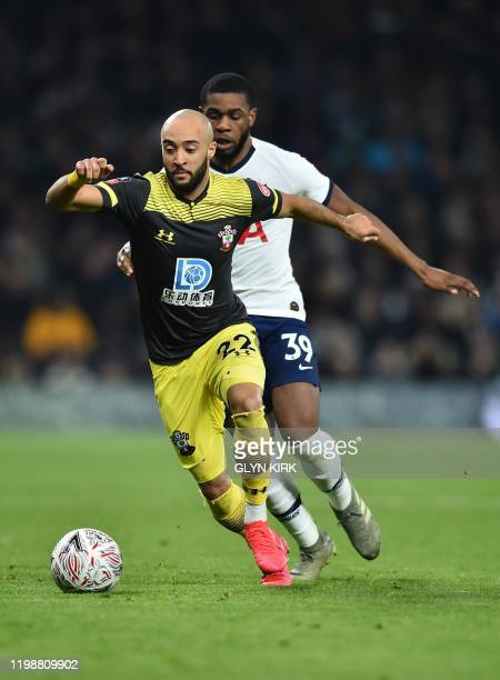 vies with Tottenham Hotspur's English midfielder Japhet Tanganga Southampton's English midfielder Nathan Redmond during the English FA Cup fourth...