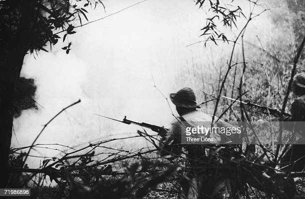 Viet Cong soldiers going into battle near Hue during the Vietnam War circa 1968