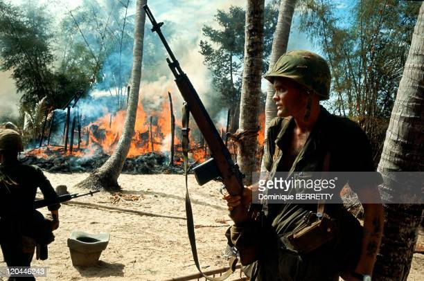 Viet Nam War in 1965 American soldiers in a burning village