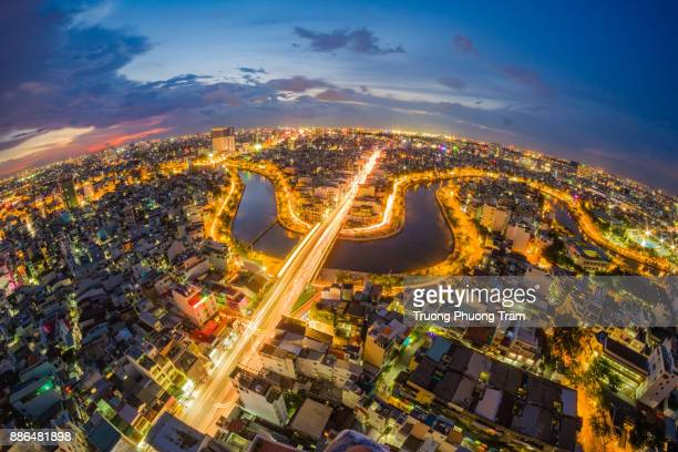 Viet Nam,Ho Chi Minh City when on the lights, viewed from above with the canal winding winding Nhieu Loc, with the sparkling electricity.