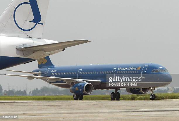 Vietnam Airlines' first Airbus A321 taxies on Hanoi's Noi Bai airport 07 July 2004 The aircraft is one of two first Airbus A321 the airliner took...
