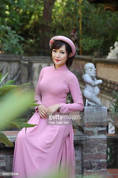Vietnam Ao Dai - Vietnamese woman in Ao Dai traditional dress sitting