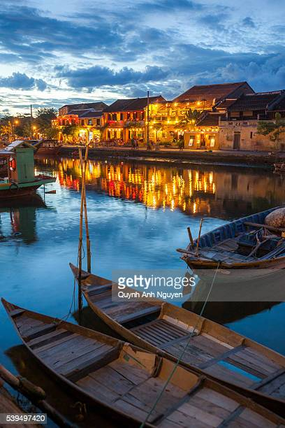 vietnam - boats on thu bon river at dusk in hoi an - hoi an stock pictures, royalty-free photos & images