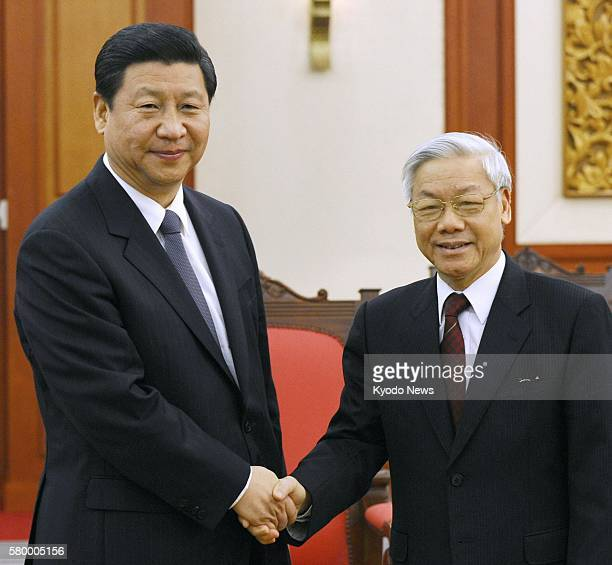 HANOI Vietnam China's Vice President Xi Jinping and Nguyen Phu Trong secretary general of the Communist Party of Vietnam's Central Committee shake...