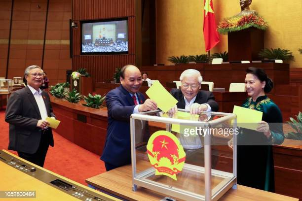 Vietnam communist party chief Nguyen Phu Trong casts his ballot to elect country's president at the National Assembly hall in Hanoi on October 23,...