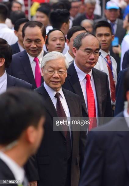 Vietnam Communist Party Secretary General Nguyen Phu Trong flanked by the party chief for Ho Chi Minh City Nguyen Thien Nhan and President Tran Dai...