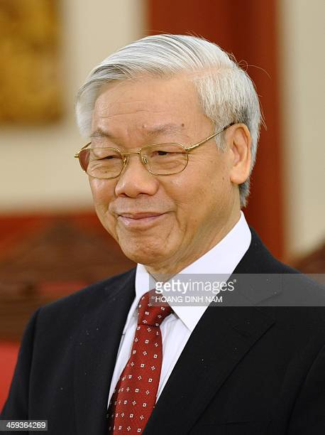 Vietnam Communist Party Secretary General Nguyen Phu Trong smiles as he waits for the arrival of the visiting Cambodian Prime Minister Hun Sen in...