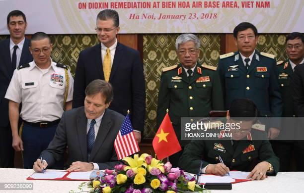 Vietnam Director Michael Greene and the Head of Vietnam's Ministry of Defense Department of Military Sciences Gen Lam Xuan Hong sign a memorandum of...