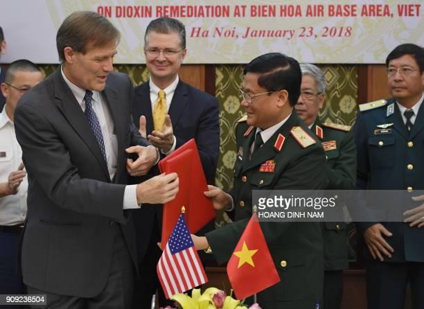 Vietnam Director Michael Greene and Vietnam's Head of Ministry of Defense's Department of Military Sciences Gen Lam Xuan Hong exchange signed...
