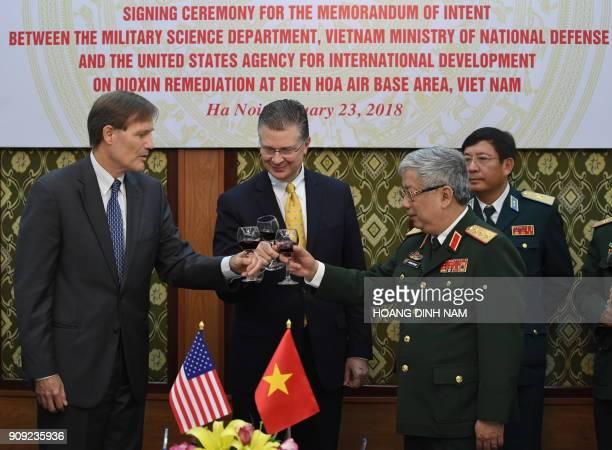 Vietnam Director Michael Greene US ambassador to Vietnam Daniel J Kritenbrink and Deputy Minister of Defense Gen Nguyen Chi Vinh raise a toast at a...