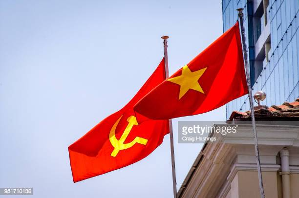 vietnam flags flying in the wind - bandiera comunista foto e immagini stock