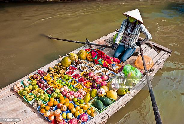 Vietnam Floating market woman selling fruit vegetables from a boat