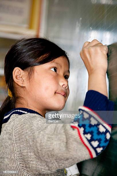 Vietnam, girl writing on blackboard.