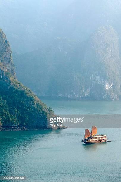 Vietnam, Halong Bay, junk ship at sea, elevated view