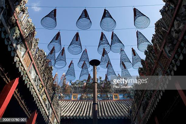 vietnam, ho chi minh city, incense coils inside thien hau pagoda - thien hau pagoda stock pictures, royalty-free photos & images