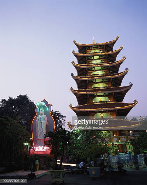 vietnam, ho chi minh city, worshippers at quoc tu pagoda, dusk - pagoda stock pictures, royalty-free photos & images