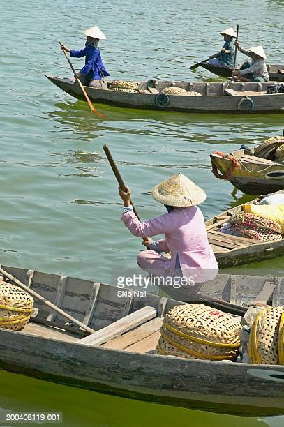 Vietnam, Hoi An, vendors in boats at fish market, side view