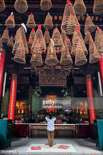 vietnam, incense coils inside temple - incense coils stock photos and pictures