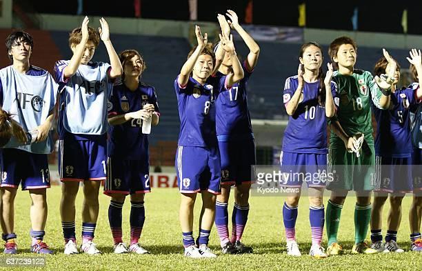 CITY Vietnam Japan captain Aya Miyama and other members of Nadeshiko Japan celebrate and acknowledge cheers from spectators after defeating Jordan in...