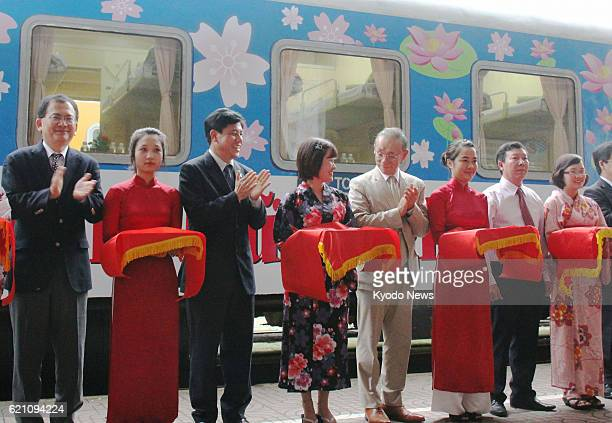 HANOI Vietnam Japanese and Vietnamese officials including Japanese Ambassador to Vietnam Yasuaki Tanizaki participate in a ribboncutting ceremony in...