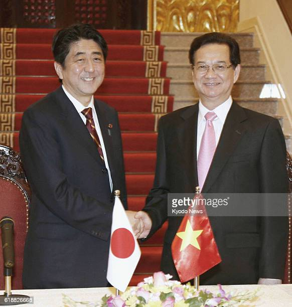 HANOI Vietnam Japanese Prime Minister Shinzo Abe and his Vietnamese counterpart Nguyen Tan Dung shake hands after holding a joint press conference in...