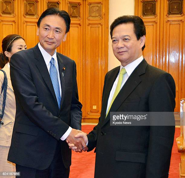HANOI Vietnam Keiji Furuya Japan's state minister in charge of the issue of North Korea's abductions of Japanese nationals shakes hands with...