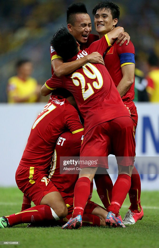 Vietnam players celebrate after beating Malaysia 2-1 during the 2014 AFF Suzuki Cup semi final 1st leg match between Malaysia and Vietnam at Shah Alam Stadium on December 7, 2014 in Kuala Lumpur, Malaysia.