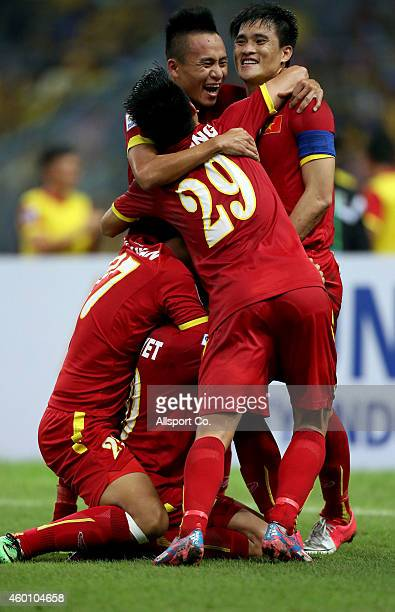 Vietnam players celebrate after beating Malaysia 21 during the 2014 AFF Suzuki Cup semi final 1st leg match between Malaysia and Vietnam at Shah Alam...